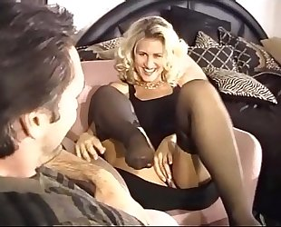 Busty golden-haired milf fucking in dark stockings