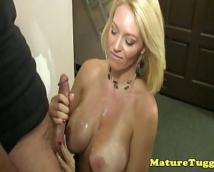 Glamour milf tugs juvenile rod over her bigtits
