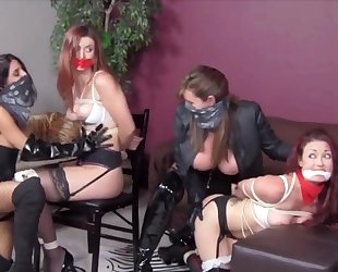 Pair of dominant chicks playing with their bound slave girls