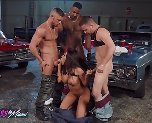 Nasty latina pleasuring 3 horny stallions in the garage