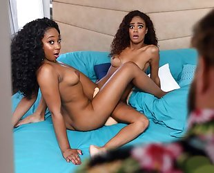 Two beautiful ebonies licking and scissoring in bed